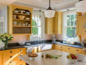 siyah kulplu sarı mutfak dolabı
